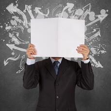 businessman with blank book and arrows choice as concept-1.jpeg